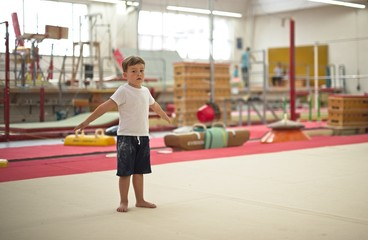 Printed roller blinds Gymnastics Little boy gymnast stands on the floor