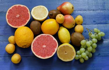 Fruit on blue wooden background.