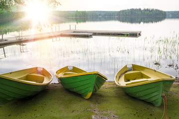 Boats on the shore of the lake, sunlight