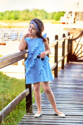 Cruise Designer Clothes | Elegant Child Girl Stands At The Bridge Pier Lady S Vogue Blue