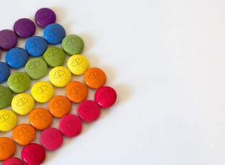 rainbow color chocolates with lesbian symbol drawn