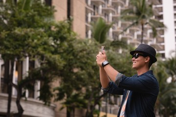 Man clicking photo with mobile phone