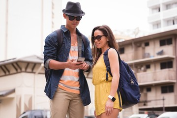 Couple reviewing pictures on mobile phone