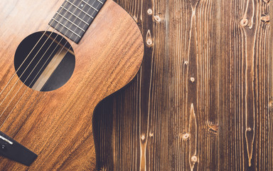 New brown guitar on wooden board Wall mural