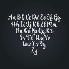 Calligraphic straight font letters on black background.Vector hand lettering alphabet.