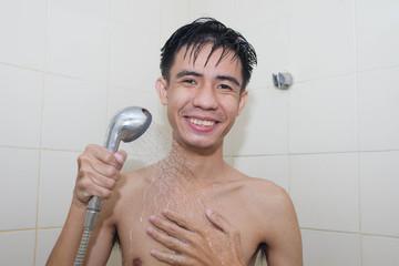 Asian man taking a shower