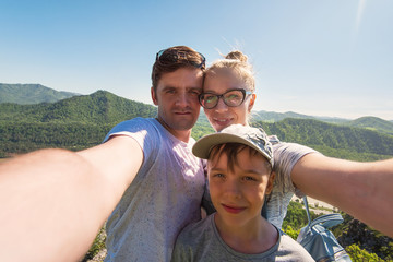 Selfie of family in mountain, beauty summer landcape