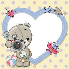 Cute Teddy Bear with a camera and a heart frame