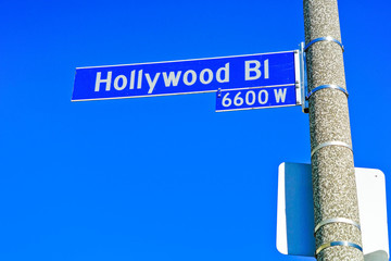 View of the Hollywood Boulevard road signs in Los Angeles on a sunny day.