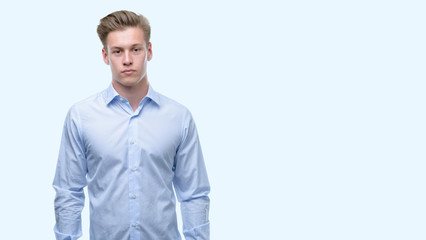 Young handsome blond man with a confident expression on smart face thinking serious