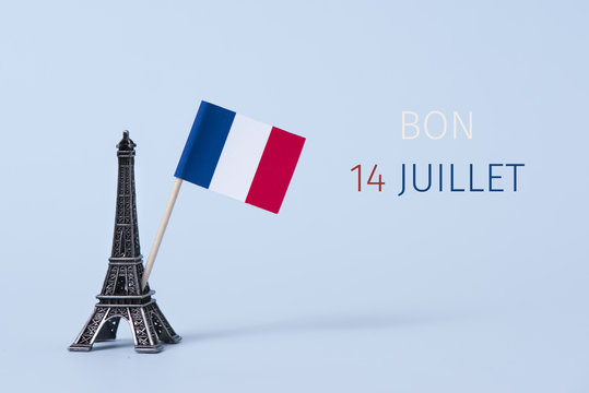 text bon 14 juillet, happy 14 july in French.