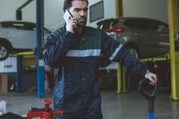 Mechanic talking on a mobile phone