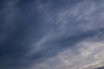 Dark cloudy sky with fleece clouds.