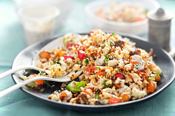 Cauliflower, quinoa & harissa spiced chickpea salad with feta and mint dressing