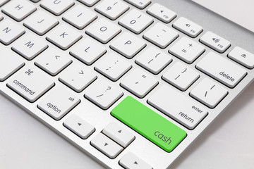 "White  keyboard with green ""CASH"" key."