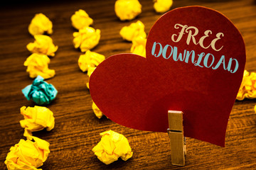 Text sign showing Free Download. Conceptual photo Files Downloading Without Any Charges Online Technology Text red heart wood clip desk crumbled paper notes yellow blue love message.