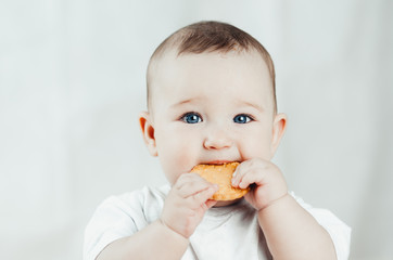 adorable baby eating a cookie