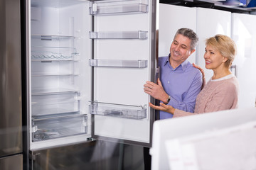Husband and wife together in shop of household appliances