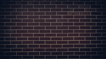 Dark brick wall with light mortar. Texture background