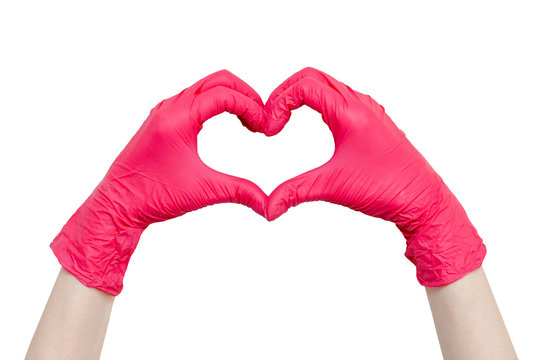 Heart made of red medical gloves isolated on white background