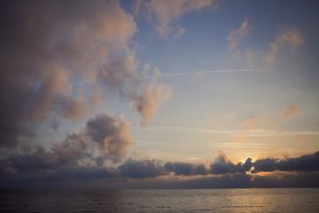 sunset clowds sea sky