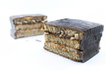 slice of chocolate cake on white background
