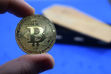 coin bitcoin drop, against the coffin