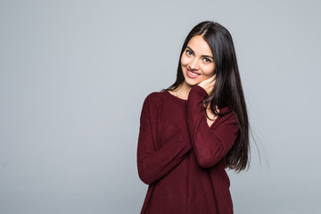 Young smile woman pretty brunette isolated on grey background