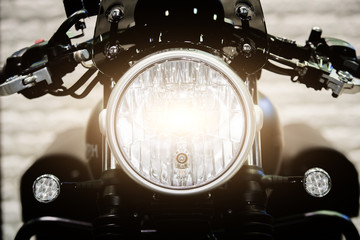 Close up Headlight of modern motorcycle in night.. Fototapete