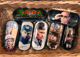 Boxes of chocolates with pictures of Russian President Vladimir Putin are seen in a convenience store in Moscow, Russia