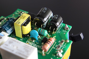 electronic circuit components on a black background