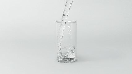 Pour water into the glass isolated on white background , 3d rendering .