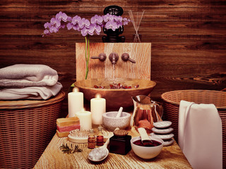 Composition of spa treatment with orchid on wooden background. Spa and wellness setting with natural soap, candles and towel.Spa still life with aromatic candles.