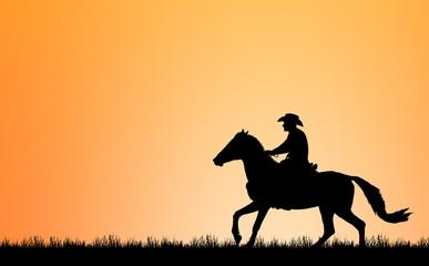 Fototapeta silhouette Cowboy riding a horse on sunrise