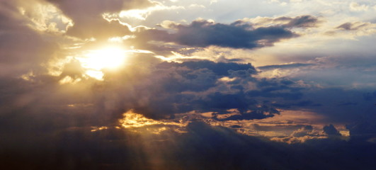 Beautiful dawn with the rays of the sun through the clouds.