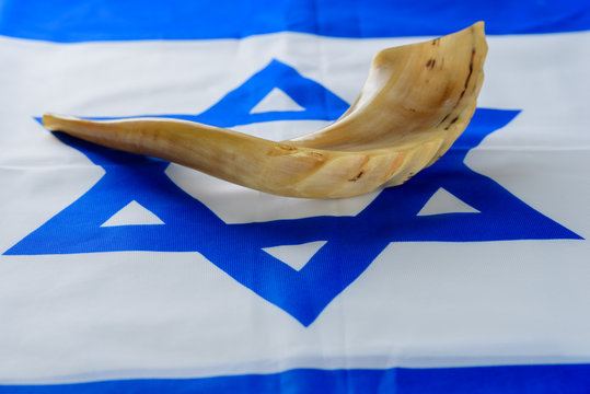 Shofar horn on Israel flag. Shofar - Yom Kippur- Day of Atonement and Rosh Hashanah Jewish holidays symbol. Image can also be used of articles on orthodox jew military service in army.