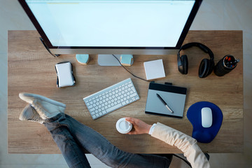 top view of business working desk - Graphic designer take a coffee break .