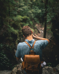 hipster capturing moments in nature