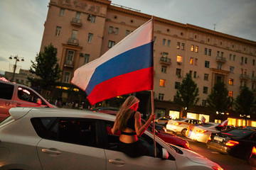 Russian people celebrating on the streets victory of the football national team during the world cup in moscow with flags