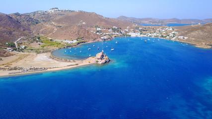 Aerial birds eye view photo taken by drone of famous rock of Kalikatsou in Petra beach, Patmos island, Dodecanese, Greece