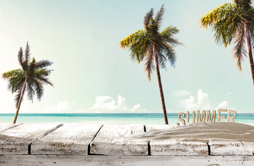 Summer background of desk and beach with palms. Free space for your decoration.