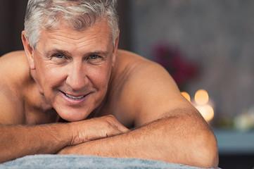 Smiling senior man at spa