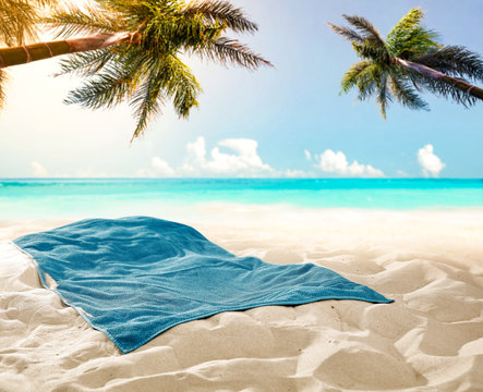 towel background on beach and free space for your decoration.