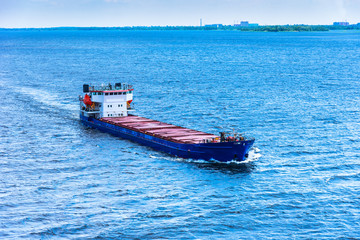 Large cargo ship in the blue sea