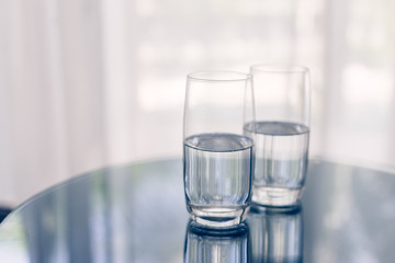 Two glasses of mineral water on the table