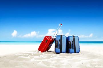 summer photo of suitcase on beach