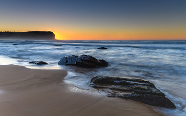 Sunrise Seascape with Rocks and Headland