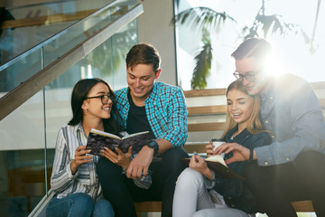 Students Studying, Reading Educational Information In College