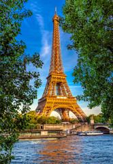 Poster Tour Eiffel Paris Eiffel Tower and river Seine at sunset in Paris, France. Eiffel Tower is one of the most iconic landmarks of Paris
