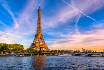 Wall Mural - Paris Eiffel Tower and river Seine at sunset in Paris, France. Eiffel Tower is one of the most iconic landmarks of Paris. Пометка для